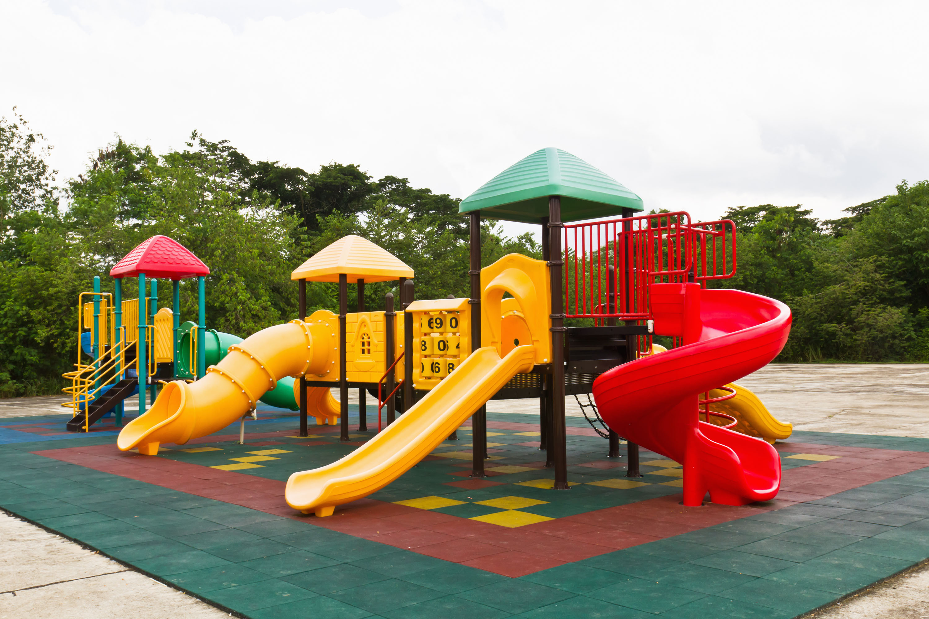 Bright, colorful playground with rubber mulch flooring